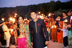 Guests cheering for Indian couple