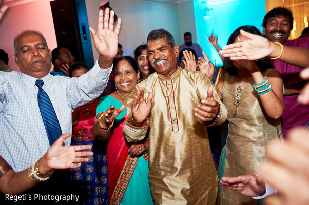 Family guests having a blast during sangeet