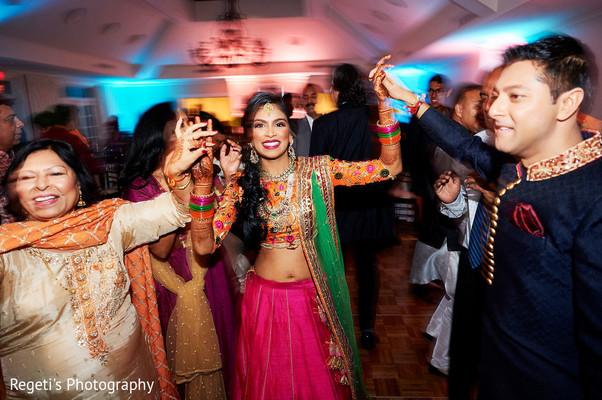 Indian bride dancing with Raja