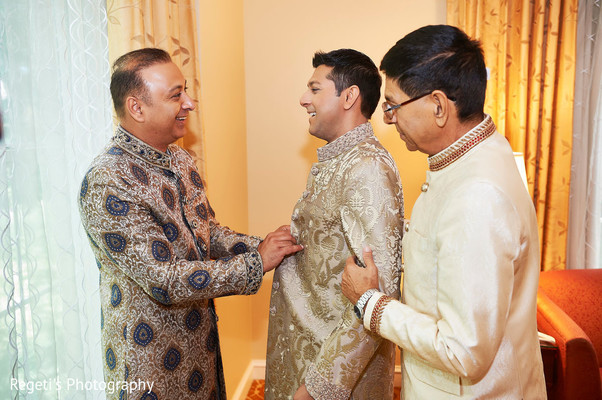 Indian groom being assisted by special guests