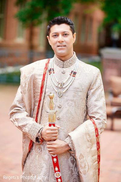 Elegant Indian groom waiting for the Maharani