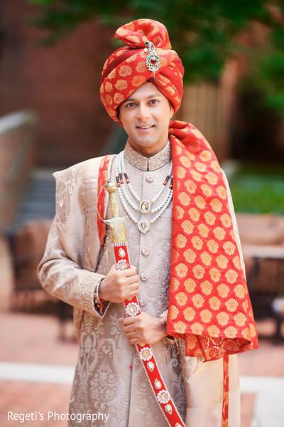 Indian groom holding the kirpan
