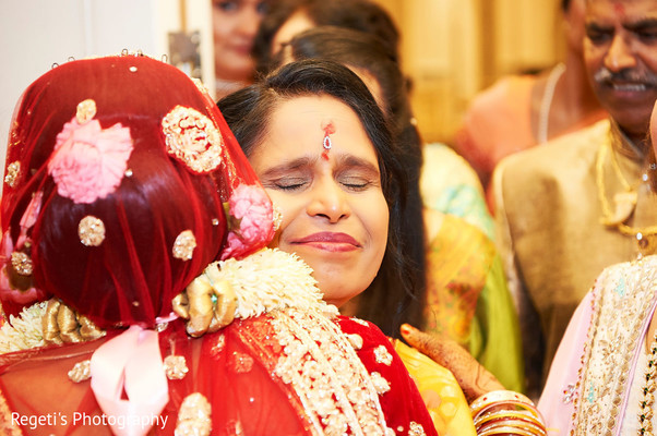 Emotional moment between Indian bride and guest