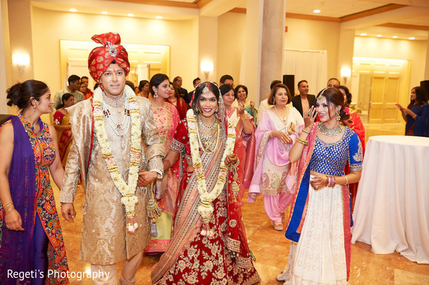 Indian bride and groom leaving the ceremony venue
