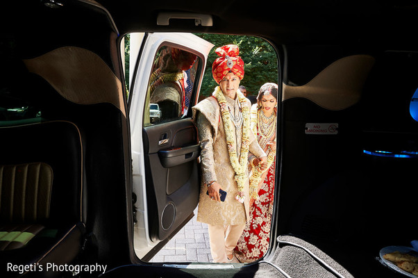 Indian couple going into the car