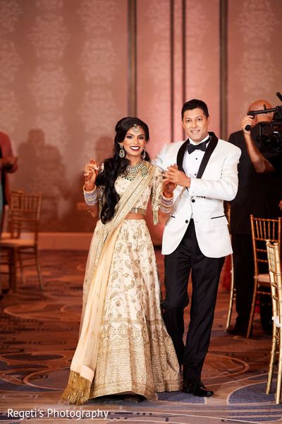 Indian bride and groom arriving