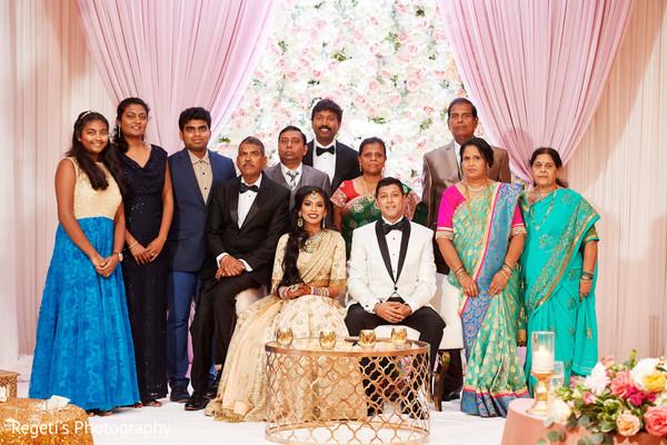 Maharani and Raja posing with family members