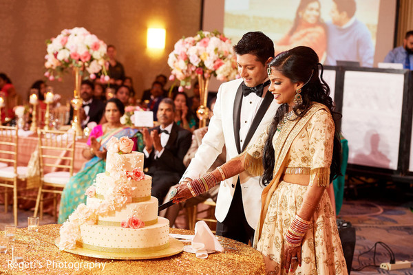 Maharani and Raja cutting the cake