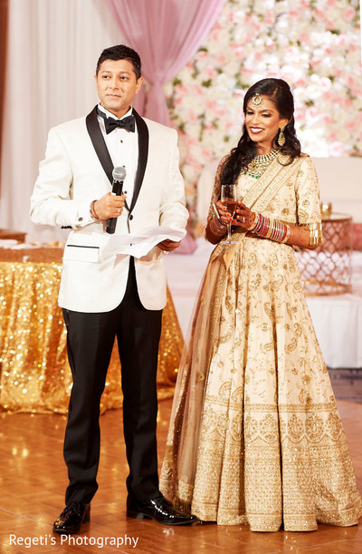 Indian bride and groom delivering a speech