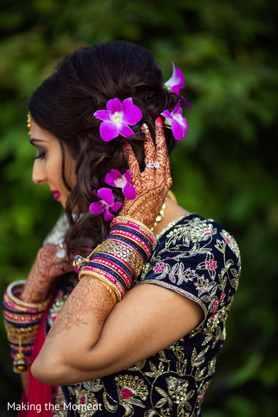 Dazzling Indian bride showing her hair design