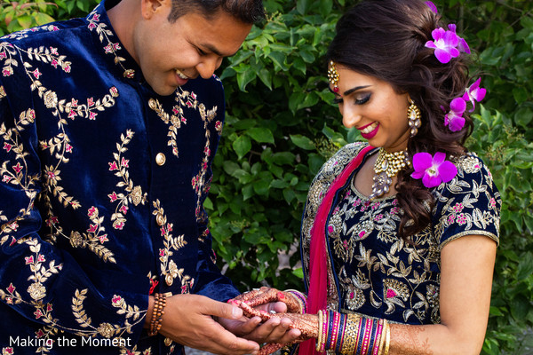 Indian bride holding hands with groom