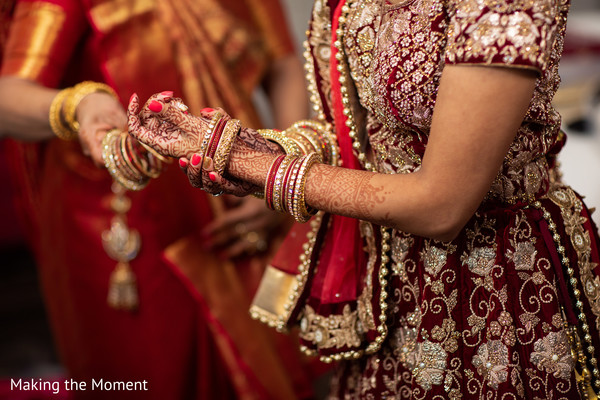 Indian bride wearing the mehndi and jewelry