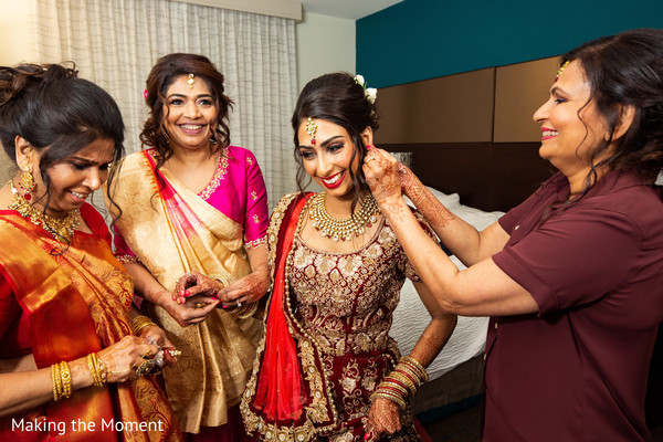 Indian bride being assisted by special guests