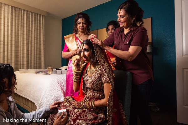 Maharani being assisted with her hair