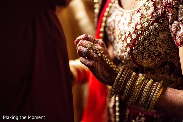 Indian bride showing her mehndi