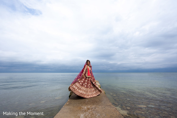 Indian bride posing by the water