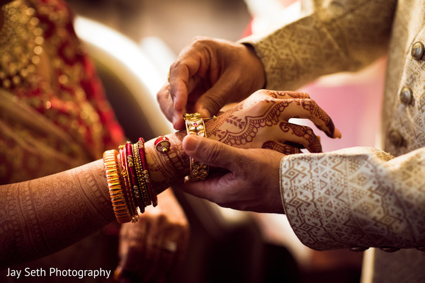 Indian bride getting her bangles on.