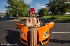 Elegant Indian groom riding baraat vehicle.