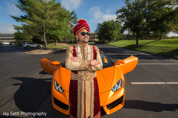 Elegant Indian groom riding baraat vehicle.