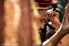 Indian groom getting the Red kum-kum mark.