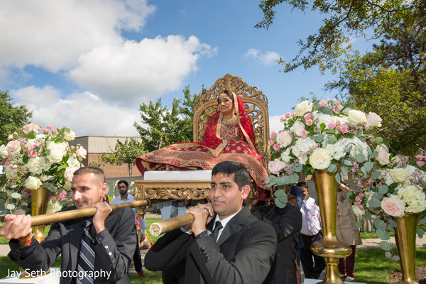 Indian bride on her doli to ceremony entrance.