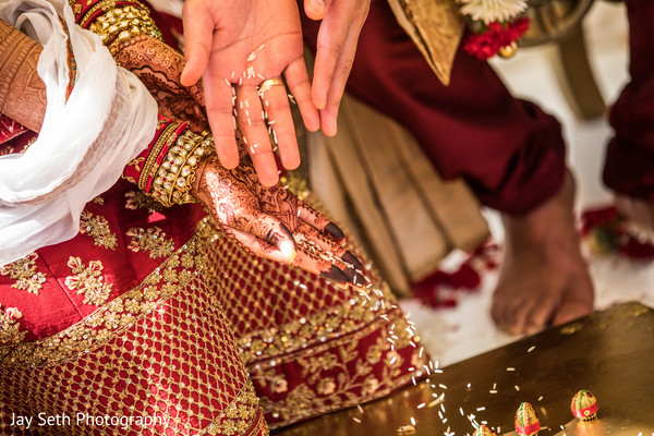 Indian wedding ritual where couple  throw the rice onto sacred fire.