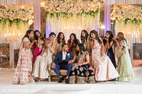 Indian couple with bridesmaids at their photo shoot.