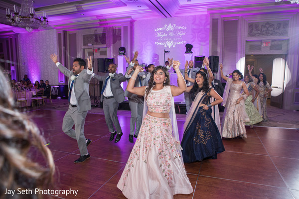 Upbeat Indian bridesmaids and groomsmen reception dance.
