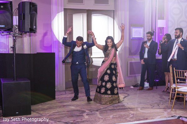 Grand entrance of Indian couple to their wedding reception.