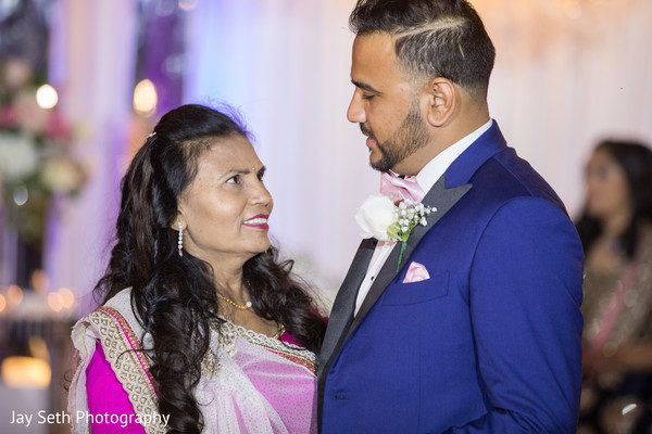 Indian groom with mother photo.