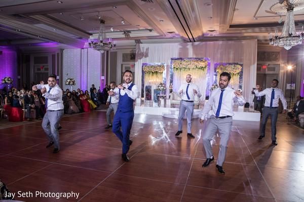 Indian groom with groomsmen reception dance.