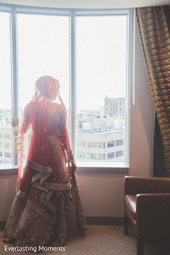 Indian bride looking out the window.