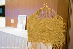 Incredible Indian wedding golden bird cage decor.
