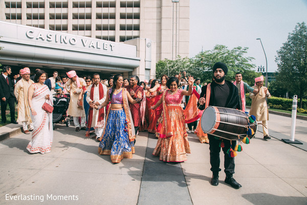 Indian Dhol player at baraat celebration.