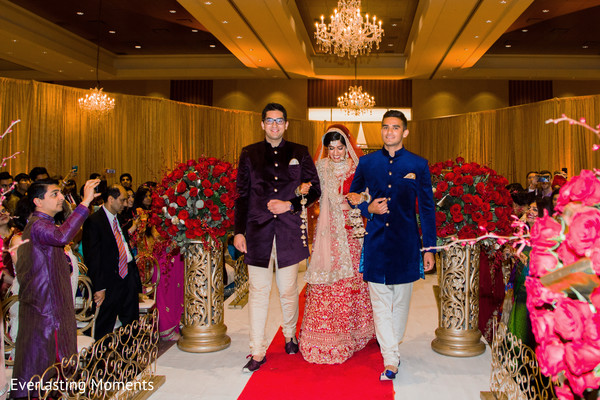 Indian bride and groomsmen entrance to ceremony.