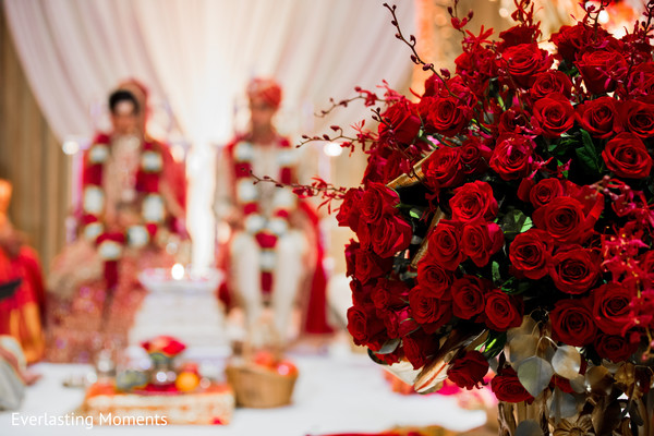 Marvelous Indian wedding ceremony red roses decor.