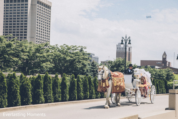 Dreamy Indian wedding horse pulled carriage.