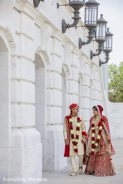 Elegant Indian bride and groom ceremony fashion.