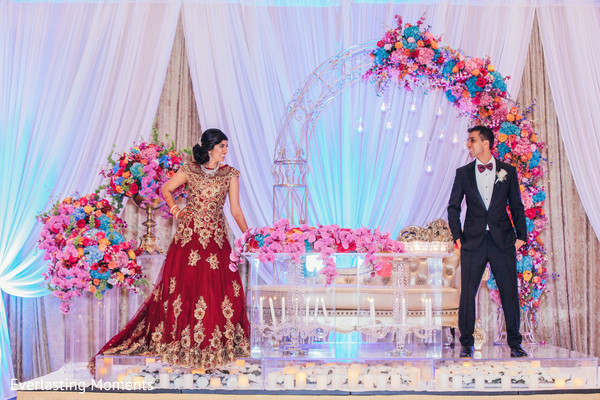 Joyful Indian couple at their reception stage capture.