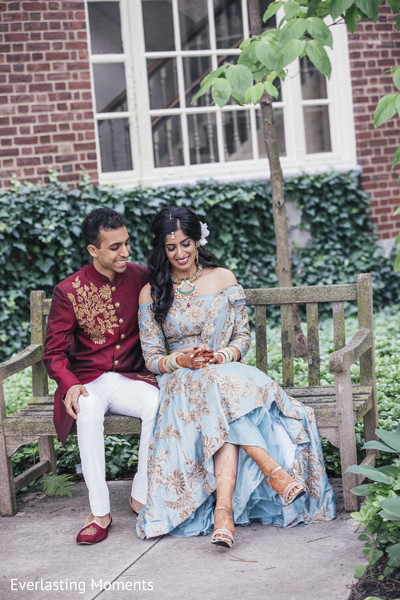 Enchanting Indian bride and groom out in garden.