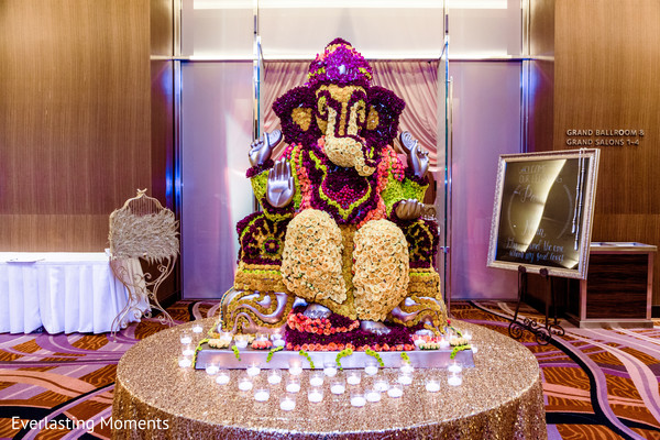 Stunning Indian wedding ganesha flowers decor.