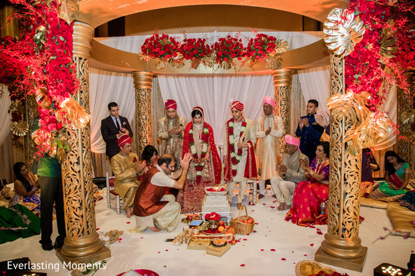 Indian couple during their wedding ceremony ritual.