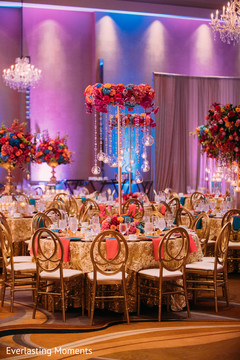 Magnificent Indian wedding table flowers and candles decor.