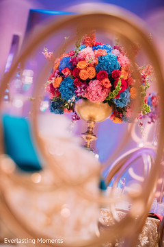 Fascinating Indian wedding table flowers decoration.