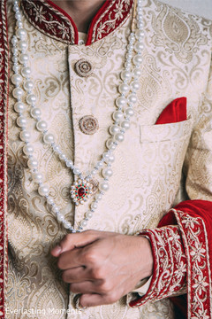 Elegant Indian groom's ceremony outfit and accessories.
