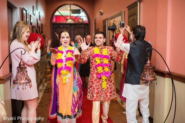 Guests cheering for the Indian couple