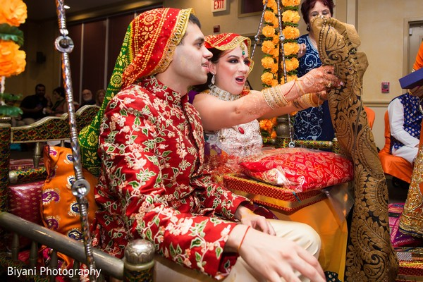 Indian bride and groom having a blast during the pre wedding rituals