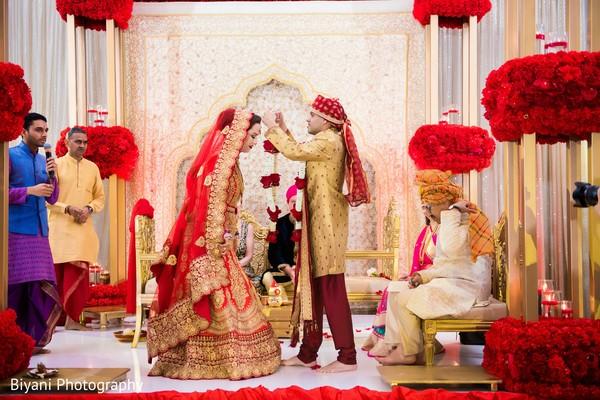 Indian groom putting the garland on the Maharani