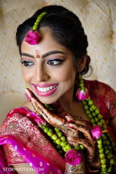 Flawless Indian bridal makeup and henna art.