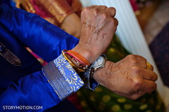 Indian groom with name on hands written with mehndi.